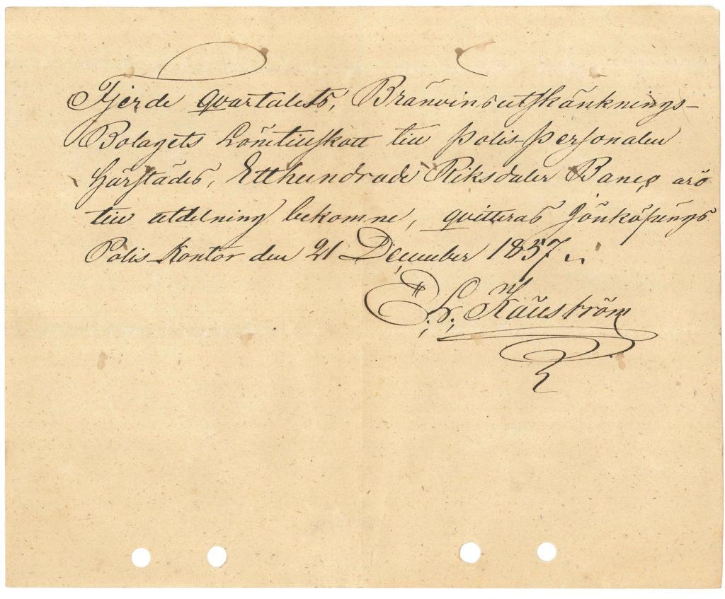 Gulnad papperslapp med snirklig svart handskrift.